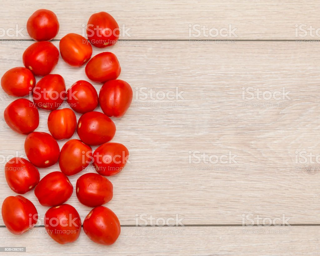 tomatoes on a wooden table, Free place for text. Top view stock photo