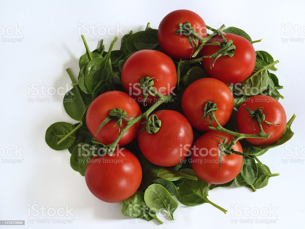 Tomatoes on Bed of Spinach royalty-free stock photo