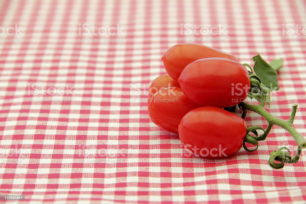 tomatoes on checkered cloth stock photo