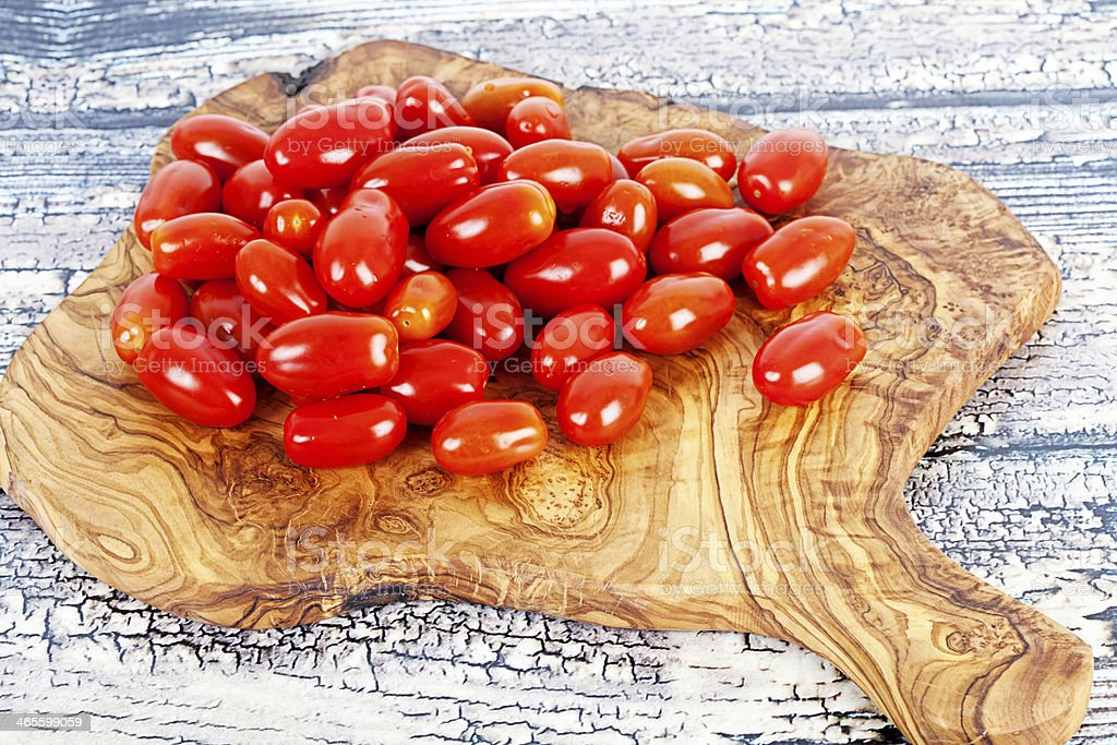 Tomatoes on Chopping Board stock photo