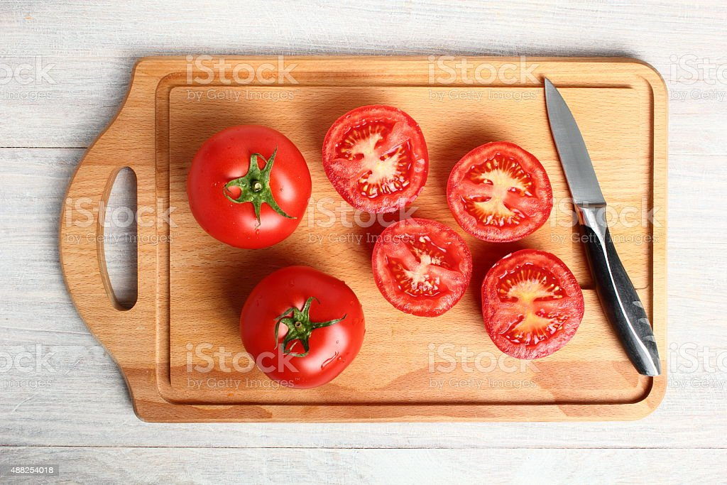 Tomatoes on cutting board stock photo