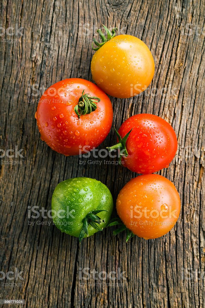 tomatoes on old wooden table stock photo