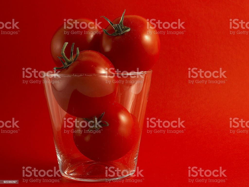 Tomatoes on red royalty-free stock photo