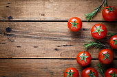 Tomatoes on rustic wood background
