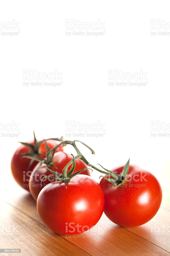 Tomatoes on Vine royalty-free stock photo