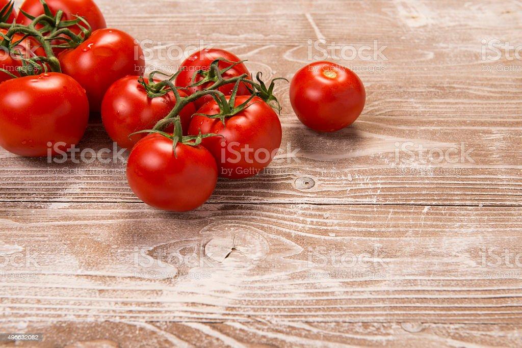 Tomatoes on white washed wood surface stock photo