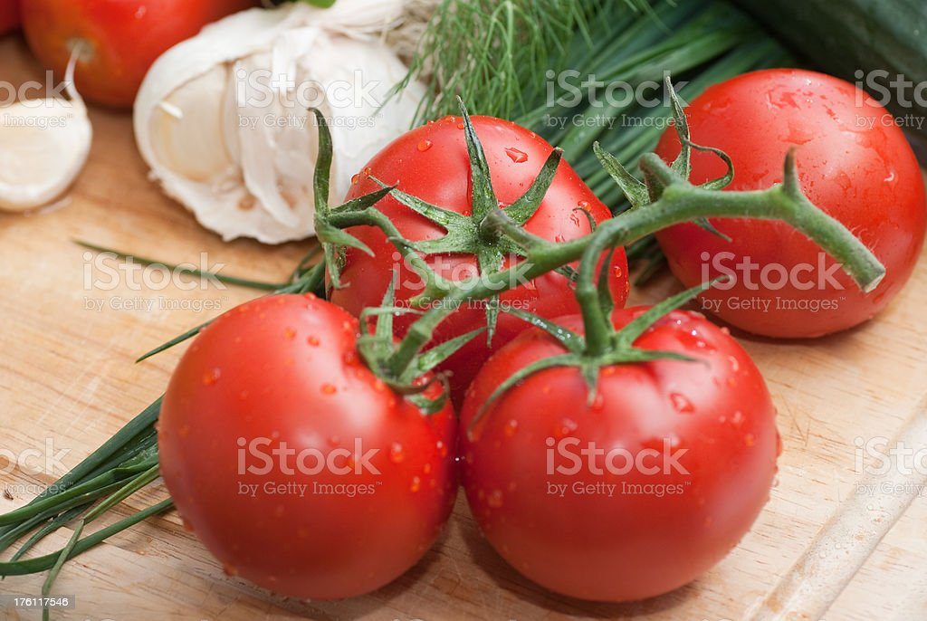 tomatoes on wodden chopping board royalty-free stock photo