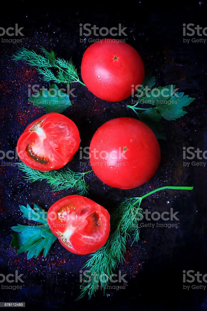 tomatoes parsley dill on an old iron stock photo