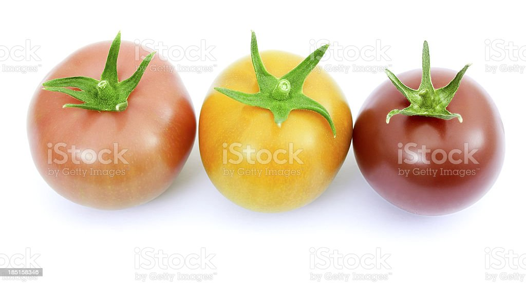 Tomatoes pink, yellow and red royalty-free stock photo