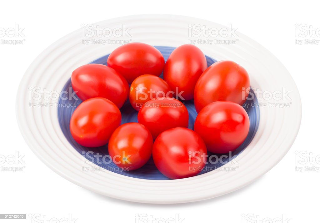 Tomatoes plum shaped in a plate stock photo