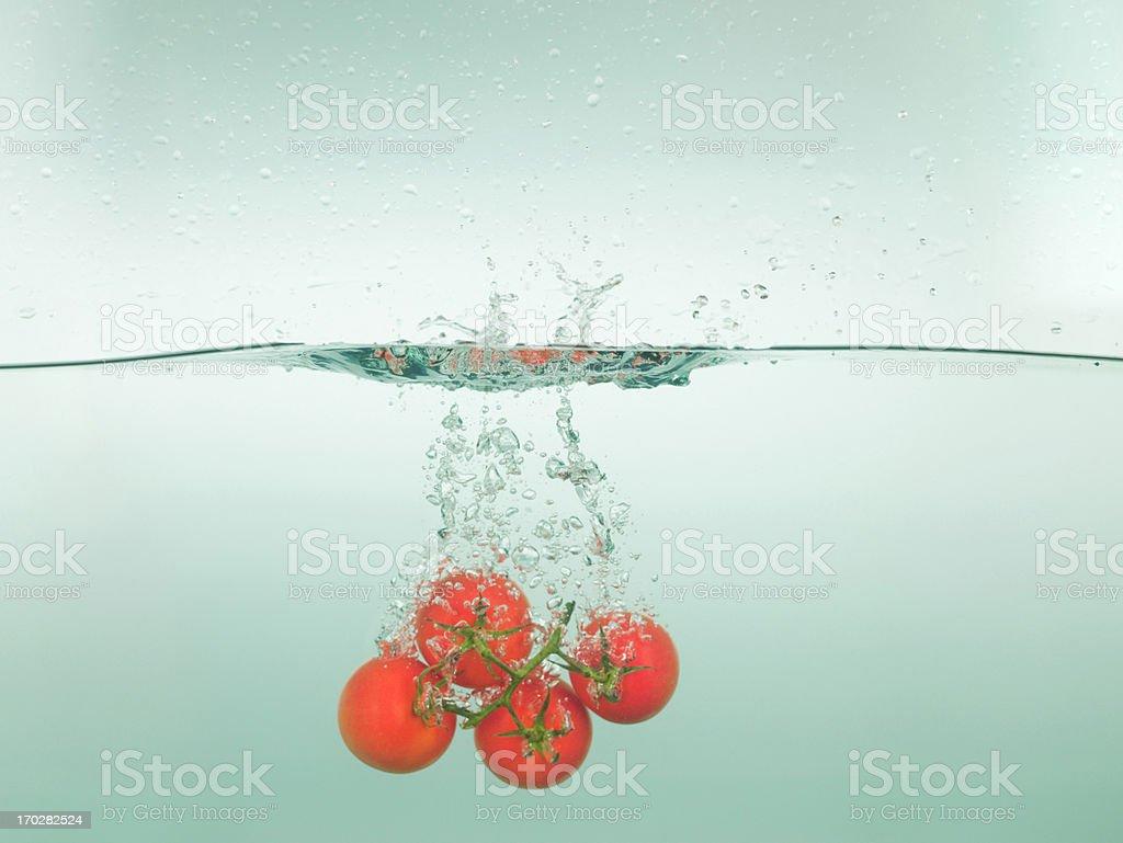 Tomatoes splashing in water royalty-free stock photo