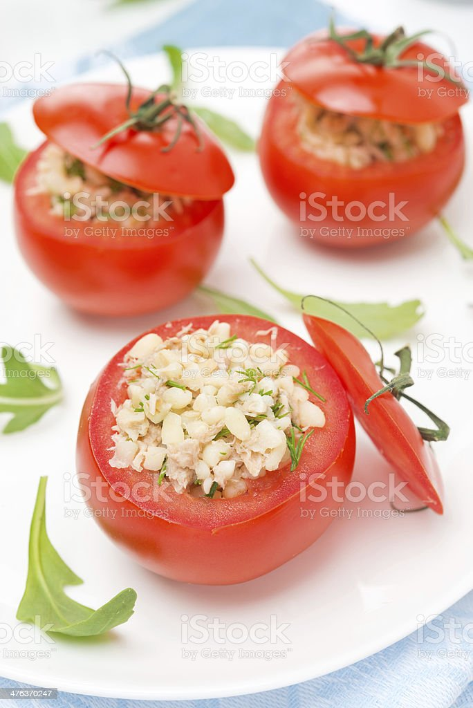 tomatoes stuffed with tuna salad, bulgur and greens, top view royalty-free stock photo