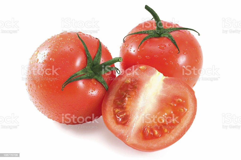 tomatoes wet trio royalty-free stock photo