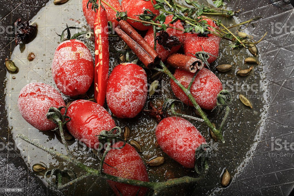 Tomatoes with Chilli, cinnamon and herbs stock photo