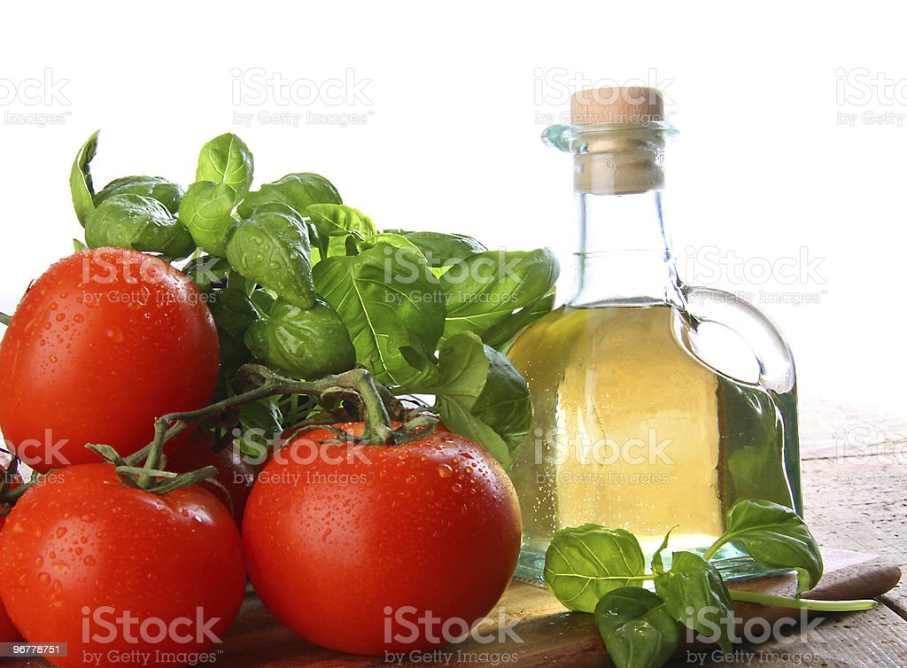 Tomatoes with fresh basil and olive oil royalty-free stock photo