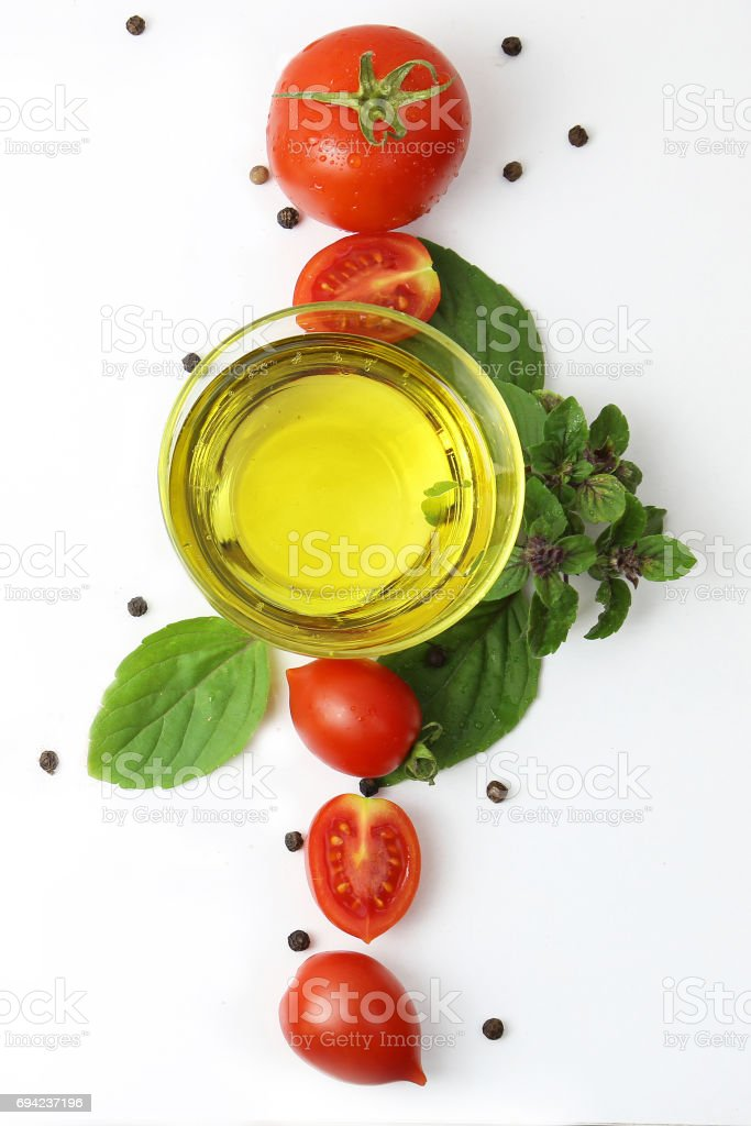 Tomatoes with Olive Oil, Basil and Black Peppercorn stock photo