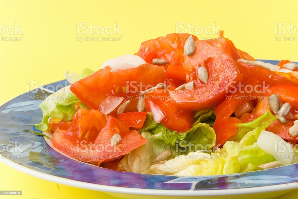 tomato-lettuce salad with seeds of sunflower 2 royalty-free stock photo
