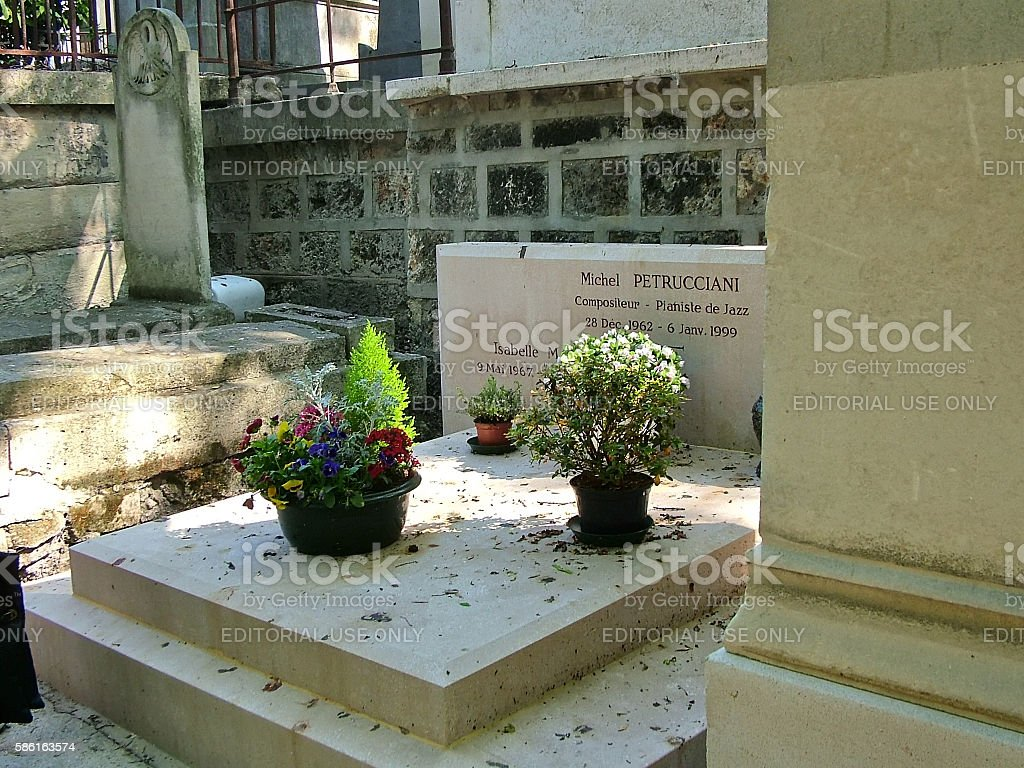 Tomb jazz pianist Michel Petrucciani in Paris stock photo