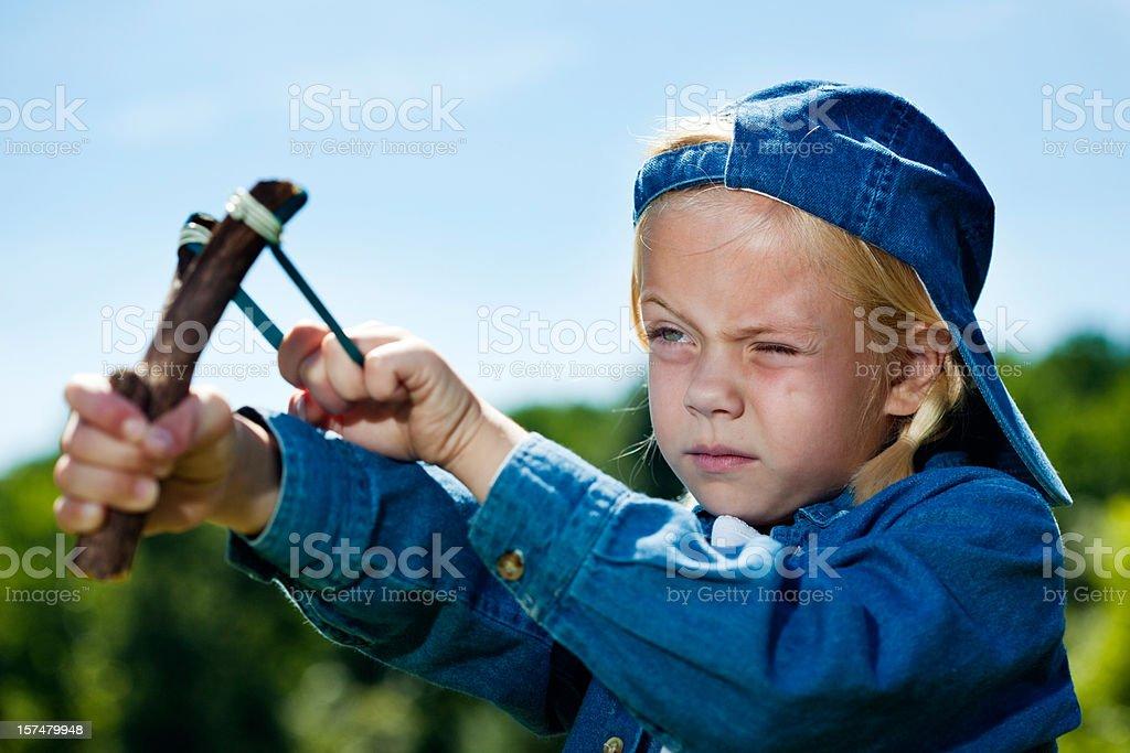 Tomboy shooting slingshot stock photo