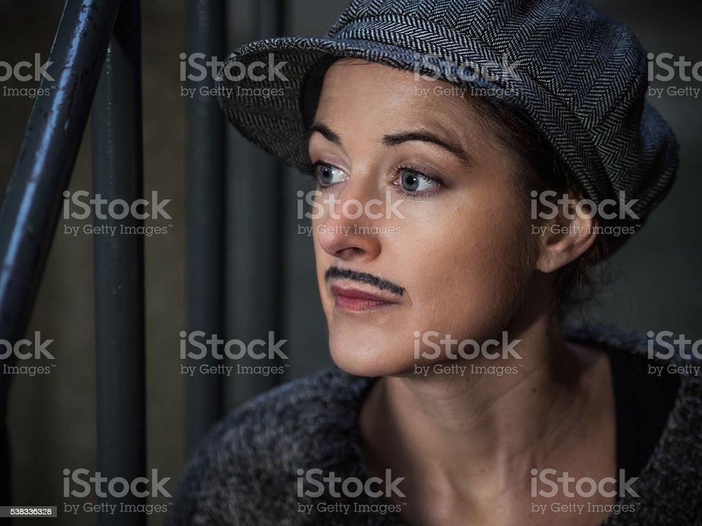Tomboy - Woman dressed up as man stock photo