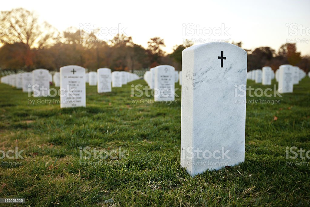 Tombstone at a cemetery royalty-free stock photo