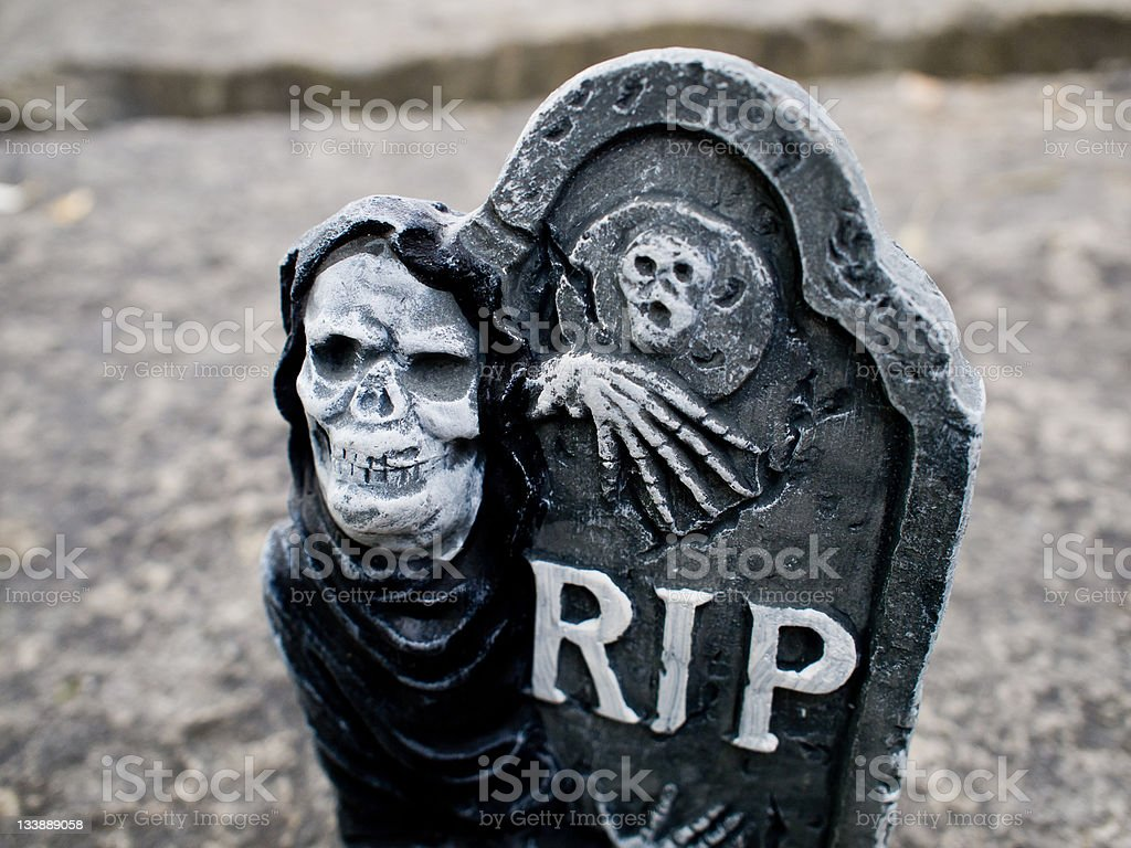 tombstone skulls skeleton halloween black and white  leafs granite spooky royalty-free stock photo