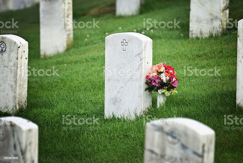 tombstone with flowers stock photo