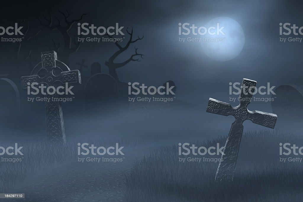 Tombstones on a spooky misty graveyard, full moon at night royalty-free stock photo