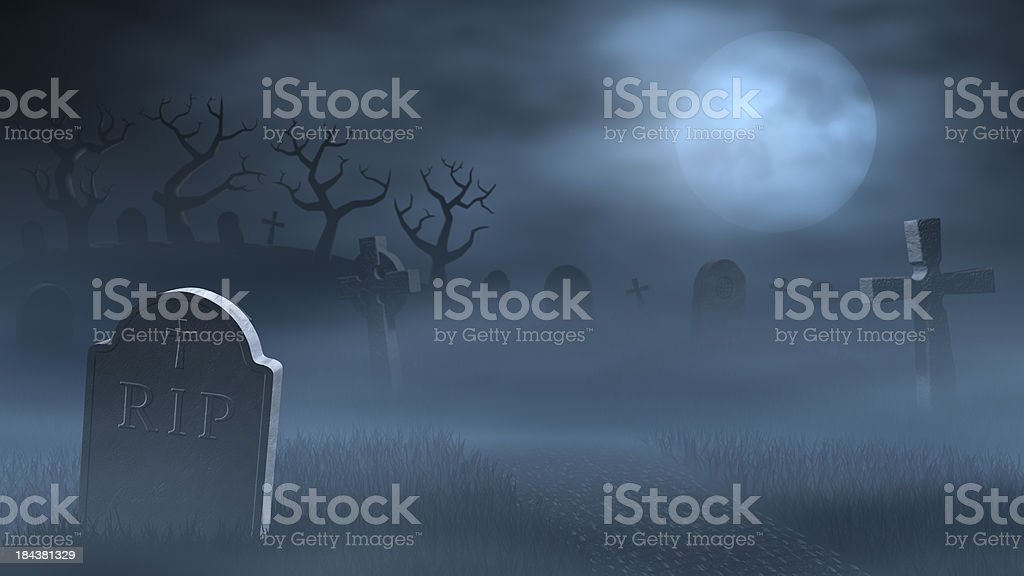 Tombstones on a spooky misty graveyard, full moon at night stock photo