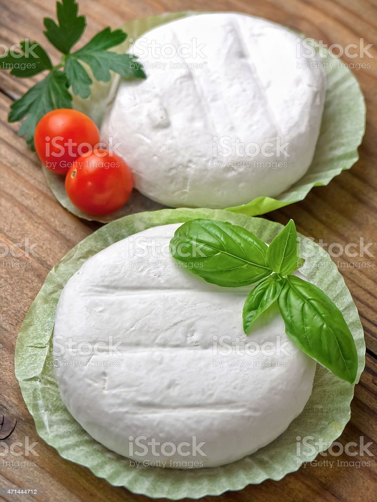 Tomini - italian cheese on wooden table stock photo