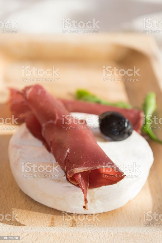 tomino cheese and bresaola stock photo