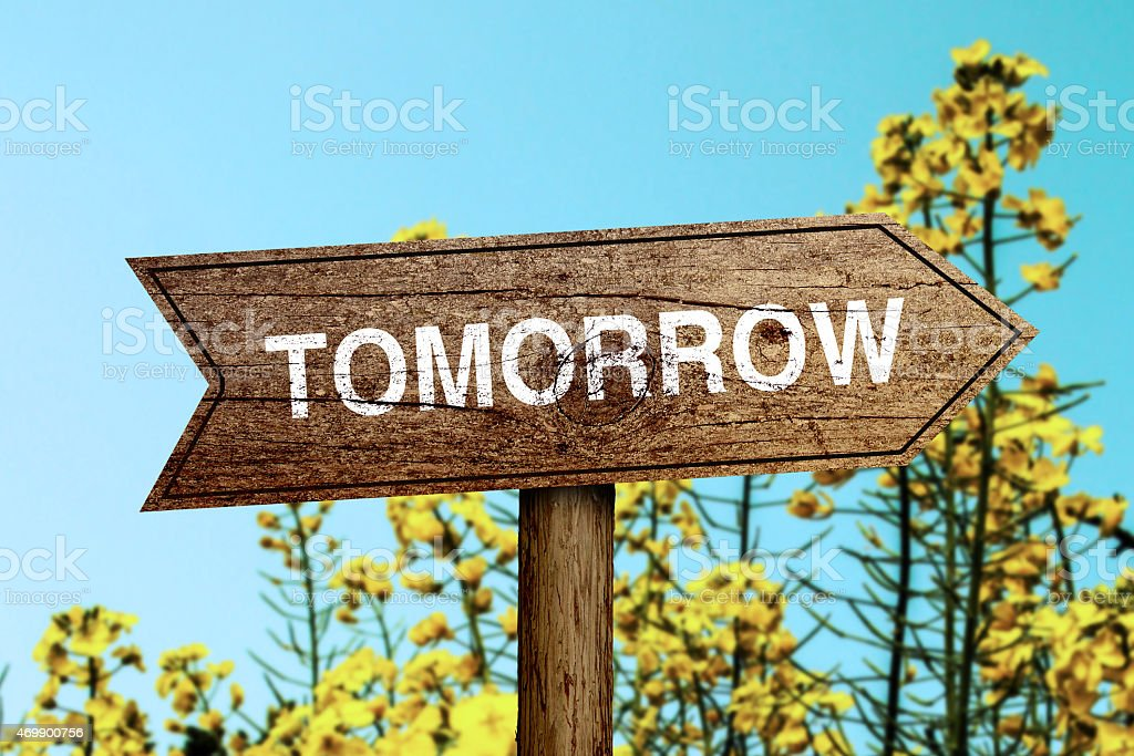 Tomorrow roadsign stock photo