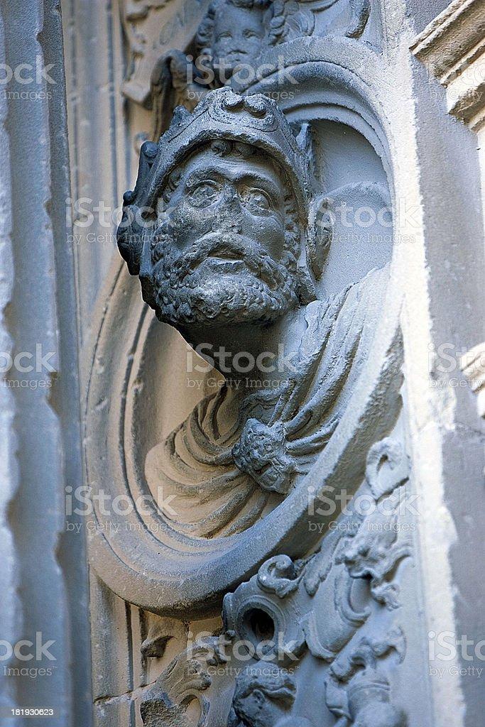 Tondo with man's image in stone, Ubeda, Jaen province, Spain stock photo