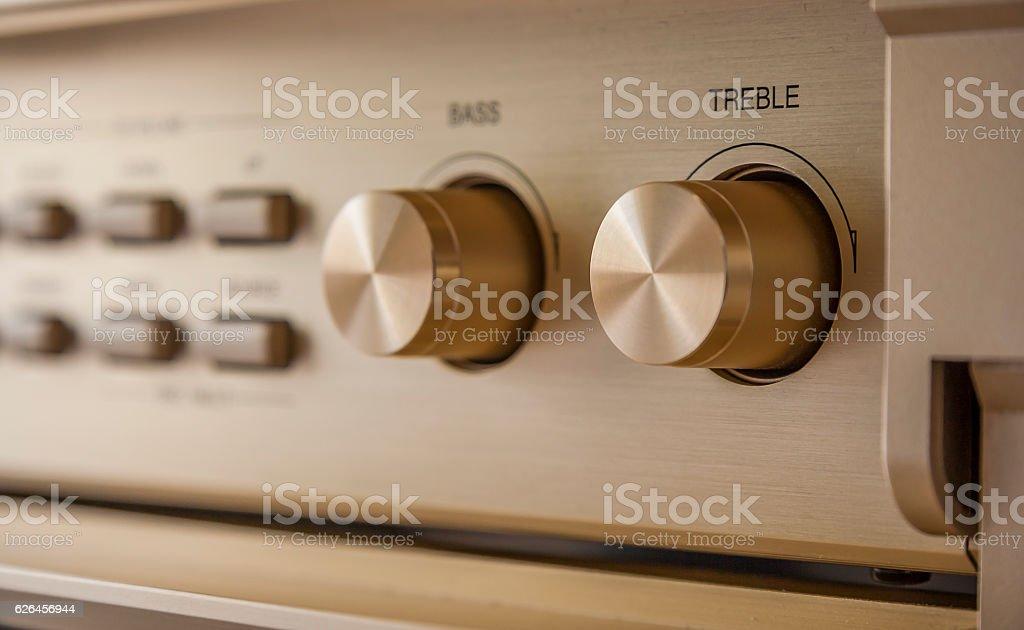 Tone control knobs of vintage Hi-Fi amplifier stock photo