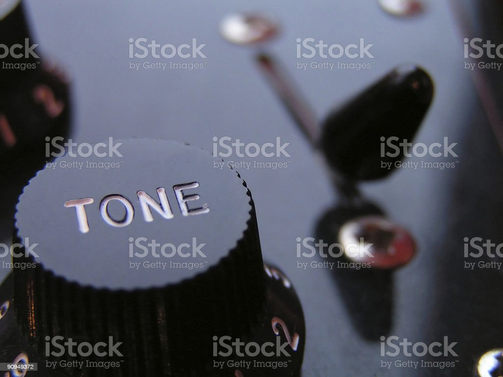 Tone control on an electric guitar stock photo