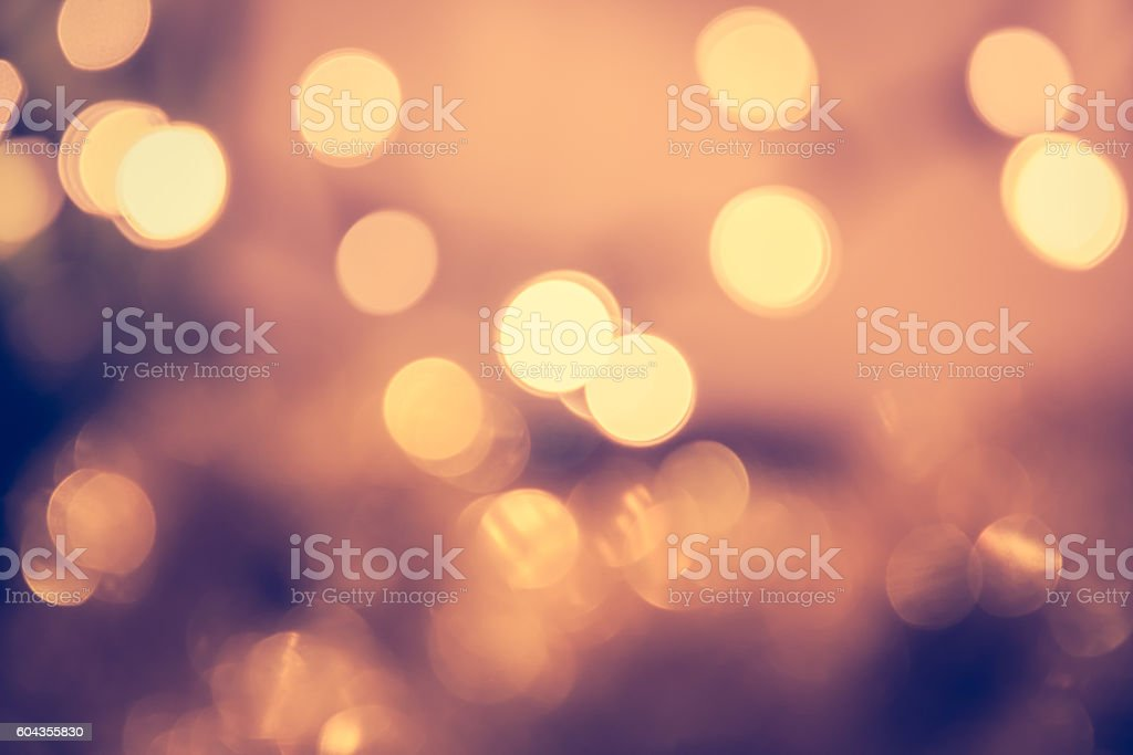 Toned bokeh with blinking Christmas lights in vintage style stock photo