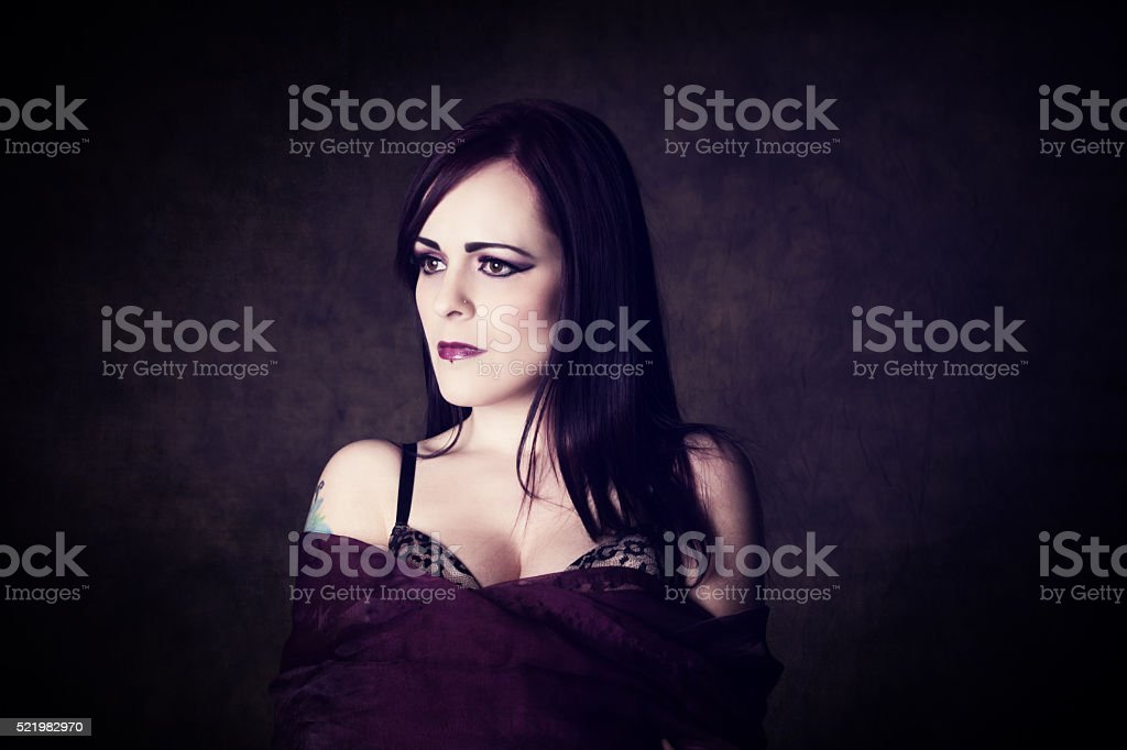 Toned colour image of young woman with purple shawl stock photo