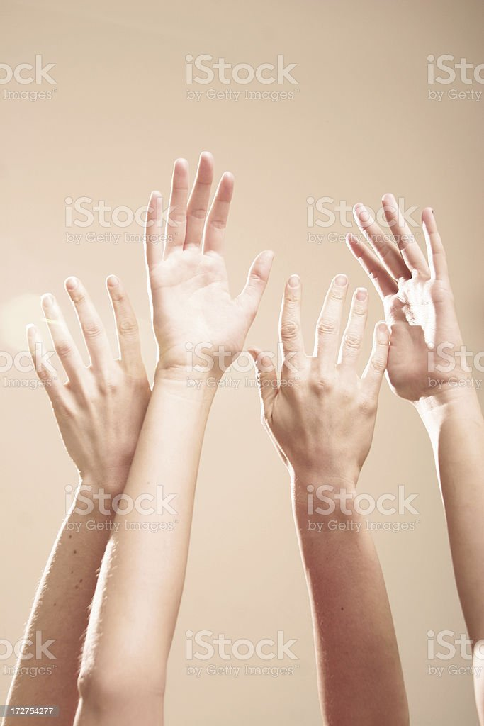 Toned Hands Raised and Open royalty-free stock photo