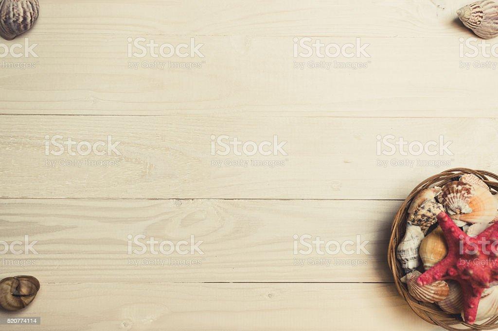 Toned image of setting of seashells and starfish on wood stock photo