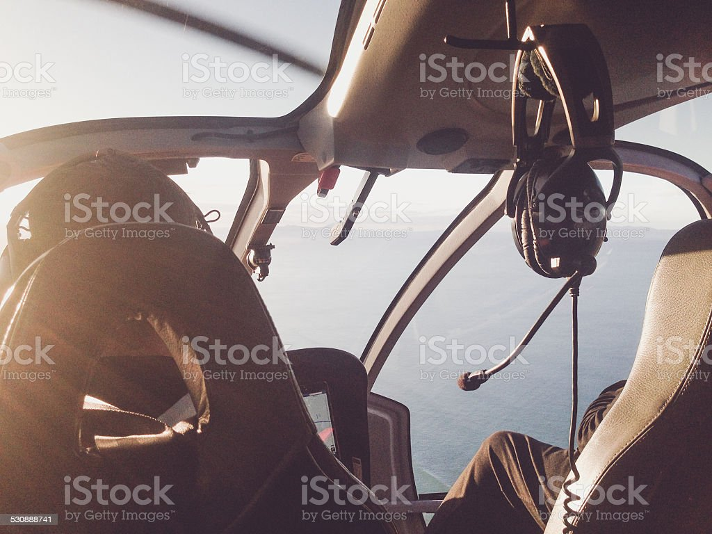 Toned photo of a Flying a helicoptor over landscape stock photo