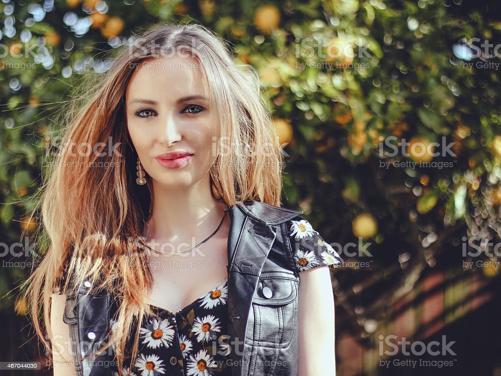 toned photo of blonde model in nature stock photo