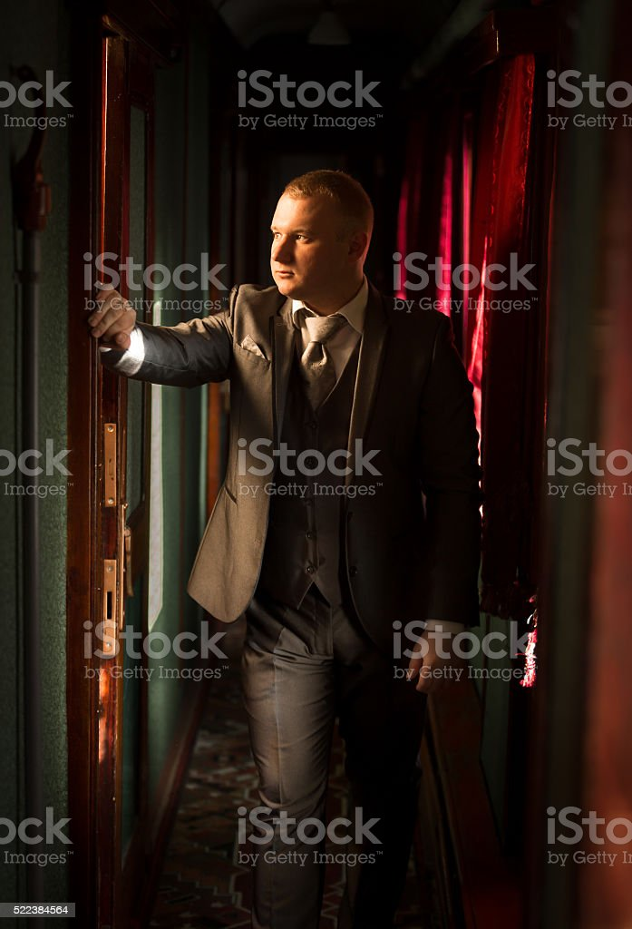 Toned portrait of man in suit at steam train stock photo