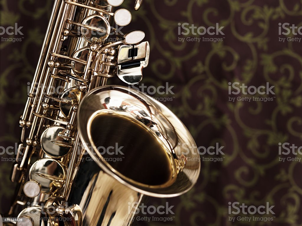 Toned shot of part of alto sax on dark background stock photo