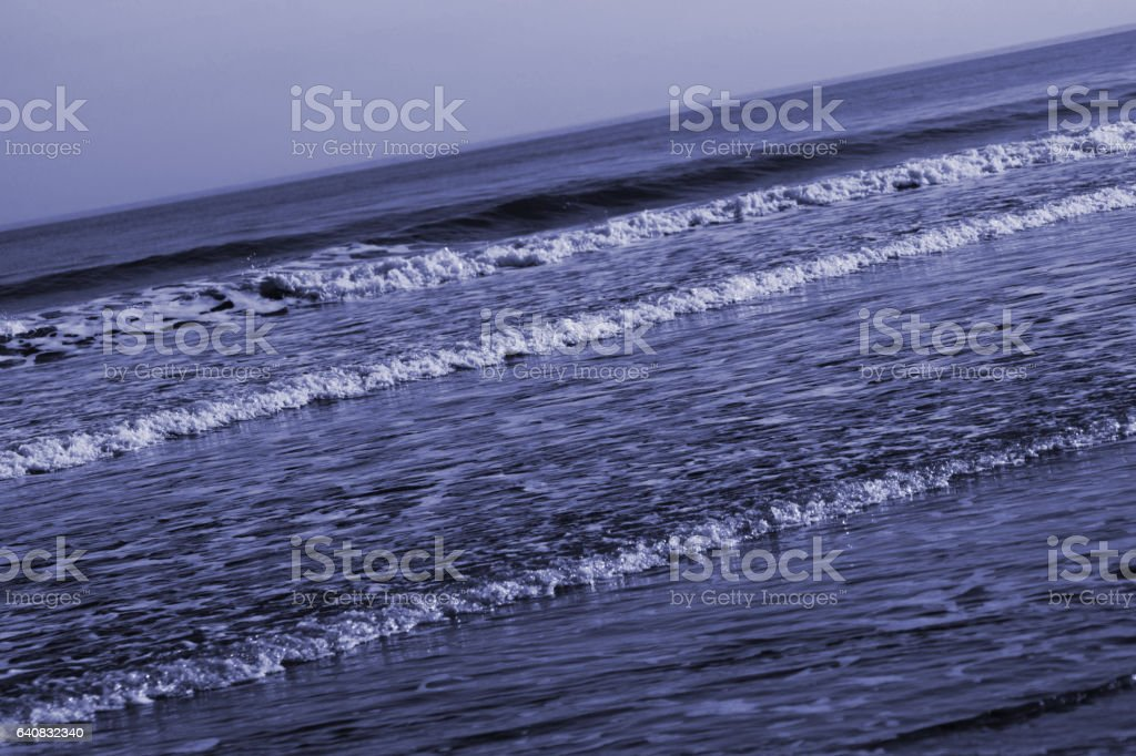 Toned wave forms on North East beach stock photo