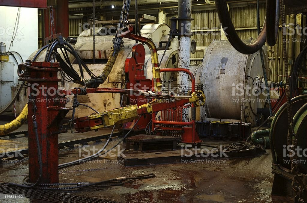 Tong, drawworks and other equipment on the drillfloor of an offs stock photo