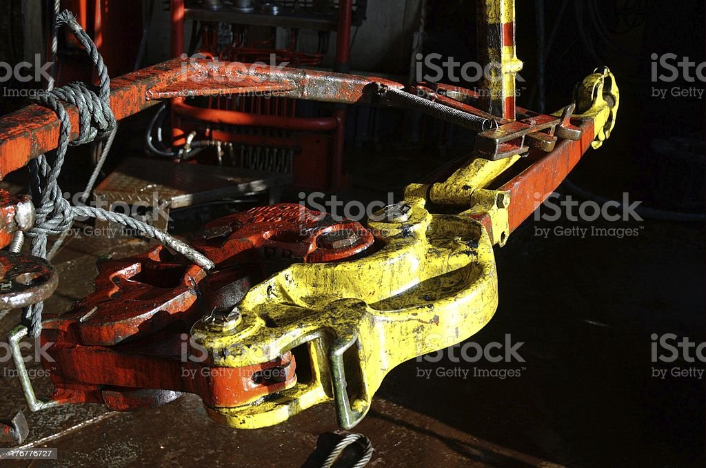 Tong used to break and make up connections on drill floor on an stock photo