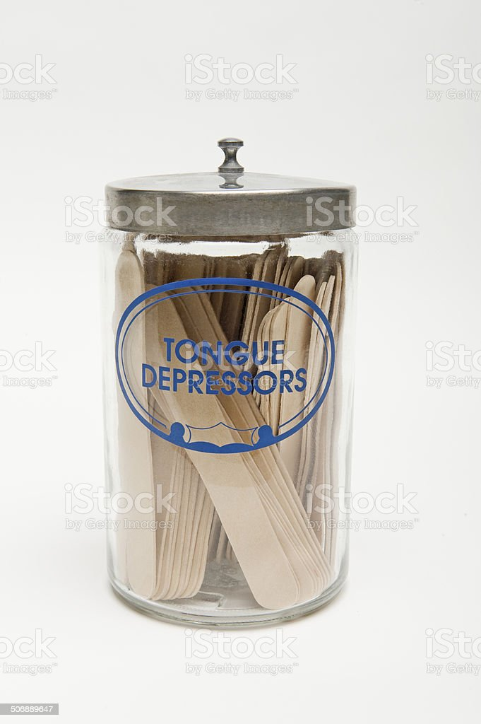 Tongue Depressors In A Glass Bottle stock photo