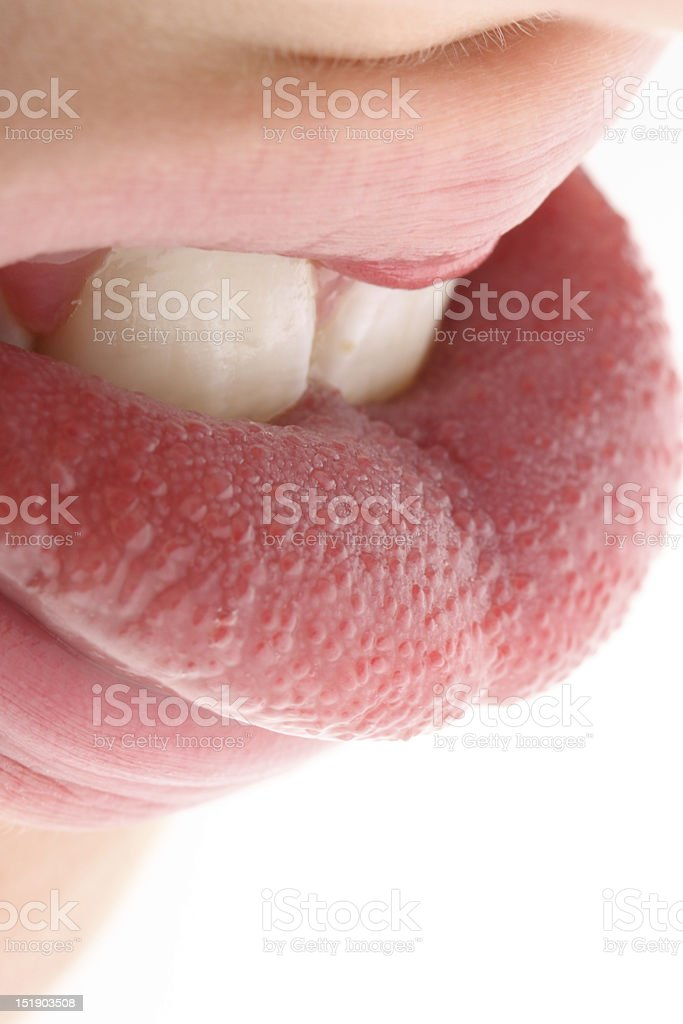 Tongue in mouth stock photo