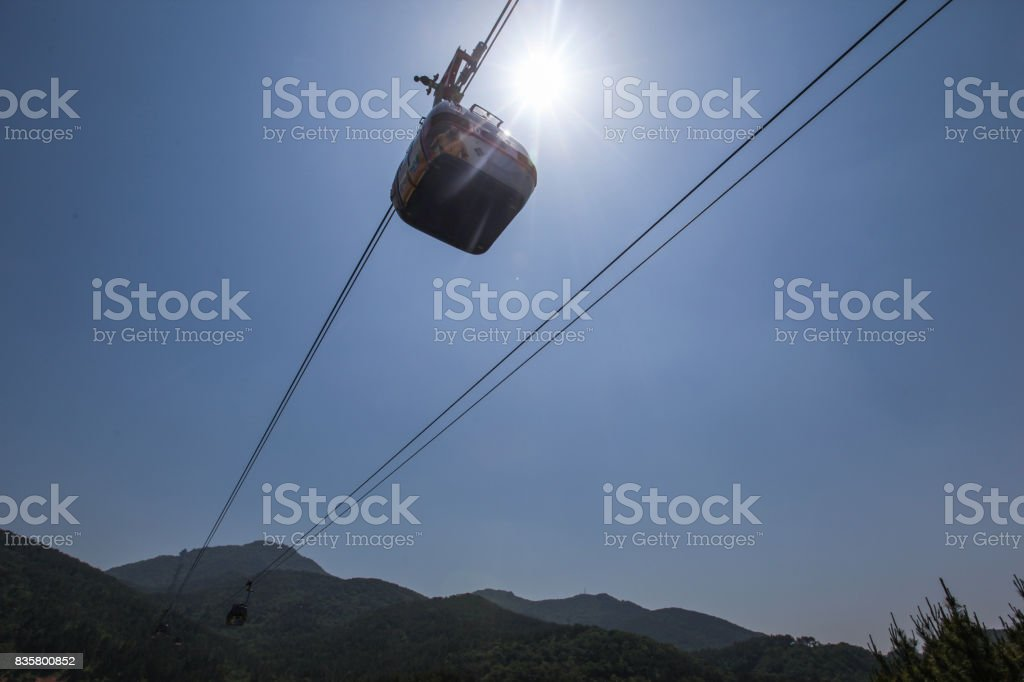 Tongyeong cable car passing under the sun stock photo