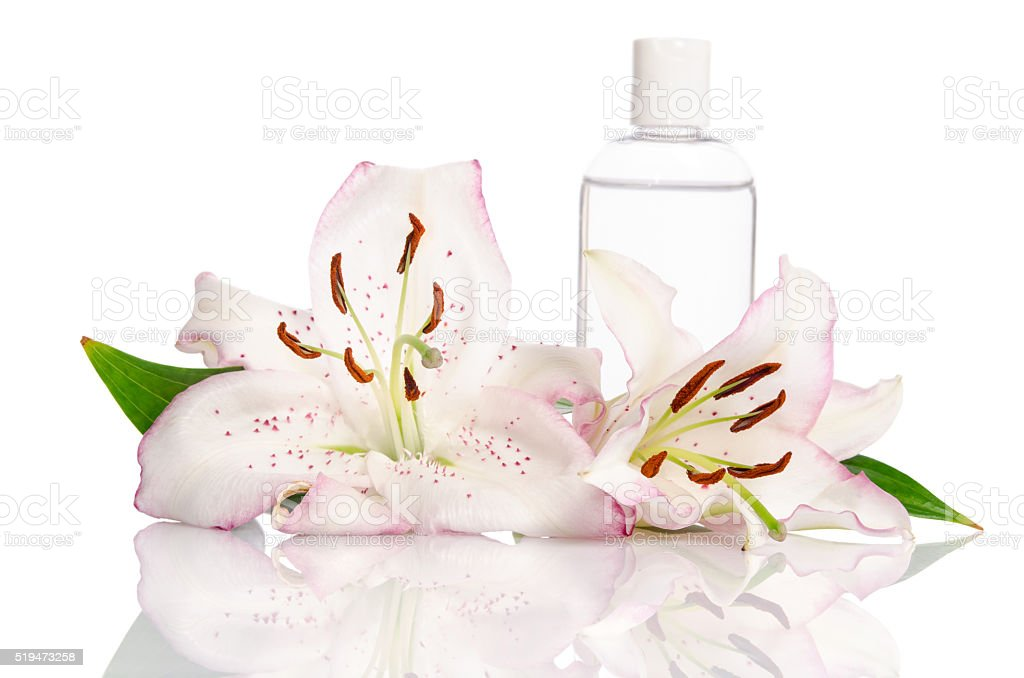 tonic for skin care with lily flowers stock photo